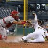 Photo - Cincinnati Reds catcher Brayan Pena, left,  tags out Pittsburgh Pirates' Andrew McCutchen to end the third inning of a baseball game in Pittsburgh Tuesday, June 17, 2014. McCutchen was attempting to score from third on a fly out to center field by Pirates Pedro Alvarez. (AP Photo/Gene J. Puskar)