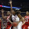 Courtney Paris shoots guarded by Monique Reid in the second half as the University of Oklahoma plays Louisville at the 2009 NCAA women\'s basketball tournament Final Four in the Scottrade Center in Saint Louis, Missouri on Sunday, April 5, 2009. Photo by Steve Sisney, The Oklahoman