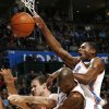 Oklahoma City\'s Desmond Mason, right, Joe Smith, middle, and Toronto\'s Kris Humphries collide on a rebound attempt during the NBA basketball game between the Toronto Raptors and the Oklahoma City Thunder at the Ford Center in Oklahoma City, Friday, Dec. 19, 2008. BY NATE BILLINGS, THE OKLAHOMAN