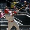 Photo - Philadelphia Phillies' Marlon Byrd connects for a single during the sixth inning of a baseball game against the Arizona Diamondbacks, Sunday, April 27, 2014, in Phoenix. (AP Photo/Ross D. Franklin)
