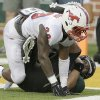 Photo - Baylor quarterback Bryce Petty, bottom, scores a touchdown and his hit hard by SMU defensive back Darrion Richardson (29) during the first half of an NCAA college football game Sunday, Aug. 31, 2014, in Waco, Texas. (AP Photo/LM Otero)