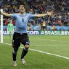 Photo - Uruguay's Luis Suarez celebrates after scoring his side's second goal during the group D World Cup soccer match between Uruguay and England at the Itaquerao Stadium in Sao Paulo, Brazil, Thursday, June 19, 2014.  (AP Photo/Matt Dunham)