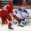 Photo - Carolina Hurricanes' Elias Lindholm (16) fires a shot at New York Rangers goalie Henrik Lundqvist during the first period of an NHL hockey game in Raleigh, N.C., Tuesday, March 11, 2014. (AP Photo/Karl B DeBlaker)