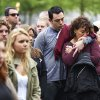 Visitors gather on the plaza of the National September 11 Memorial to watch a telecast of the dedication ceremony for the National September 11 Memorial Museum in New York, Thursday, May 15, 2014. (AP Photo/The Daily News, James Keivom, Pool)