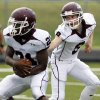 Jenks quarterback Mark Ginther (9) hands the ball off to Jordan Towers (21) during the high school football scrimmage between Mustang and Jenks at Mustang High School in Mustang, Okla., August 17, 2007. By Nate Billings, The Oklahoman