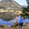 Emili and Andrew Mitchell relax beside Mary\'s Lake. They recently vacationed in Colorado with grandparents Gary and Miriam Mitchell. Community Photo By: Gary Mitchell Submitted By: Gary,