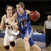 the Class B girl\'s semi final game Lomega\'s Kylie Turner drives past Balko\'s Jaylee Mays between Lomega and Balko at the State Fair Arena in Oklahoma City, Friday, March 2, 2012. Photo by Sarah Phipps, The Oklahoman