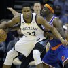 Memphis Grizzlies\' Rudy Gay (22) is pressured by New York Knicks\' Ronnie Brewer, right, during the first half of an NBA basketball game in Memphis, Tenn., Friday, Nov. 16, 2012. (AP Photo/Danny Johnston)
