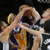 Los Angeles Lakers\' Dwight Howard, center, is defended by San Antonio Spurs\' Tim Duncan, left, and Tiago Splitter, of Brazil, in the first half of an NBA basketball game in Los Angeles, Tuesday, Nov. 13, 2012. (AP Photo/Jae C. Hong)