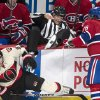 Photo - Linesman Brian Pancich, center, goes over the boards after being caught in between Montreal Canadiens' P.K. Subban, right, and Ottawa Senators' Milan Michalek during the first period of an NHL hockey game Saturday, March 15, 2014, in Montreal. (AP Photo/The Canadian Press, Paul Chiasson)