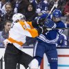 Toronto Maple Leafs\' Nazem Kadri, right, battles for the puck with Philadelphia Flyers\' Braydon Coburn during the second period of an NHL hockey game, Saturday, March 8, 2014 in Toronto. (AP Photo/The Canadian Press, Chris Young)