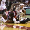 Photo - Miami Heat's Shane Battier (31) and Chris Andersen, right, battle Washington Wizards' Kevin Seraphin (13) for the ball during the first half of an NBA basketball game in Miami, Sunday, Nov. 3, 2013. (AP Photo/J Pat Carter)