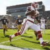 Oklahoma\'s Damien Williams (26) rushes for a touchdown in the first quarter during a college football game between the University of Oklahoma Sooners (OU) and the Notre Dame Fighting Irish at Notre Dame Stadium in South Bend, Ind., Saturday, Sept. 28, 2013. Photo by Nate Billings, The Oklahoman