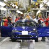 Photo - In this March 14, 2014 file photo, a 2015 Chrysler 200 automobile moves down the assembly line at the Sterling Heights Assembly Plant in Sterling Heights, Mich. All automakers report U.S. sales figures for August 2014 on Wednesday, Sept. 3, 2014. Chrysler and Nissan both posted double-digit U.S. sales gains last month, signs of strong August for the industry. (AP Photo/Paul Sancya, File)