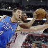 Oklahoma City Thunder forward Nick Collison (4) and Los Angeles Clippers guard Chris Paul (3) tangle in the second half of an NBA basketball game in Los Angeles, Sunday, March 3, 2013. The Thunder won 108-104. (AP Photo/Reed Saxon)