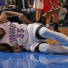 Oklahoma City\'s Kevin Durant (35) grabs his side after falling to the ground during an NBA basketball game between the Oklahoma City Thunder and the Miami Heat at Chesapeake Energy Arena in Oklahoma City, Thursday, Feb. 15, 2013. Miami won 110-100. Photo by Bryan Terry, The Oklahoman