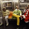 FILE - This Dec. 11, 2010 file photo shows John Paul, center, of Manhattan, dressed as an Elf and Michael Smallwood, of Brooklyn, dressed as Santa riding the E train downtown in New York. Paul and Smallwood were participating in SantaCon a annual pub crawl where participants dress up in Santa and other Christmas theme outfits. SantaCon is coming to town _ in fact, to nearly 300 towns and cities around the world. Dozens, sometimes hundreds of red-suited revelers gather, bar hop, stop traffic and pose for photos. (AP Photo/Mary Altaffer, file)