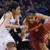 Photo - Iowa State guard Nikki Moody (4) drives around Oklahoma State guard Tiffany Bias (3) in the second half of an NCAA college basketball game in the quarterfinals of the Big 12 Conference women's college tournament in Oklahoma City, Saturday, March 8, 2014. Oklahoma State won 67-57. (AP Photo/Sue Ogrocki)