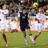 United States\' Abby Wambach heads a ball past China\'s Wang Dongni and Wu Haiyan (26) for a goal during the first half of an exhibition soccer match, Wednesday, Dec. 12, 2012, in Houston. (AP Photo/David J. Phillip)