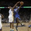 Orlando Magic shooting guard E\'Twaun Moore (55) shoots next to Golden State Warriors guard Jarrett Jack (2) during the second quarter of an NBA basketball game in Oakland, Calif., Monday, Dec. 3, 2012. (AP Photo/Jeff Chiu)