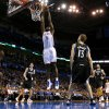 Oklahoma City\'s Serge Ibaka (9) dunks the ball during an NBA basketball game between the Oklahoma City Thunder and the Minnesota Timberwolves at Chesapeake Energy Arena in Oklahoma City, Wednesday, Jan. 9, 2013. Photo by Bryan Terry, The Oklahoman