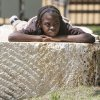 Lakeven McCully, from Eugene Field Elementary School, rests on a rock bench during the Festival of the Arts in downtown Oklahoma City, OK, Thursday, April 25, 2013, By Paul Hellstern, The Oklahoman