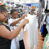 Photo -  Dearius Gardner, 13, and his mom, Delisha, look for school clothing at the Belle Isle Wal-Mart during the tax-free weekend. Photo by Paul Hellstern, The Oklahoman   PAUL HELLSTERN -  Oklahoman