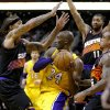 Los Angeles Lakers\' Kobe Bryant (24) is pressured by Phoenix Suns\' Michael Beasley, left, Shannon Brown (6), and Markieff Morris (11) during the first half on an NBA basketball game, Wednesday, Jan. 30, 2013, in Phoenix. (AP Photo/Matt York)