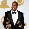 FILE - In this Feb. 10, 2013 file photo, Jay-Z poses backstage with the awards for best rap/sung collaboration for