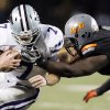 OSU\'s Anthony Rogers gets some of the face mask of KSU quarterback Collin Klein (7) in the fourth quarter during a college football game between the Oklahoma State University Cowboys (OSU) and the Kansas State University Wildcats (KSU) at Boone Pickens Stadium in Stillwater, Okla., Saturday, Nov. 5, 2011. OSU won, 52-45. Photo by Nate Billings, The Oklahoman ORG XMIT: KOD