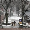 A couple walks through a near-deserted Faneuil Hall Marketplace as snow falls on Friday, Feb. 8, 2013. A major winter storm is heading toward the U.S. Northeast with up to 2 feet of snow expected for a Boston-area region that has seen mostly bare ground this winter. (AP Photo/Elise Amendola) ORG XMIT: MAEA108