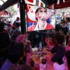 Photo - French soccer supporters watch a live broadcast of the group E World Cup soccer match between Switzerland and France, in the Metro14th District bar in Paris, France, Friday, June 20, 2014. The match ended in a 5-2 win for France. (AP Photo/Francois Mori)