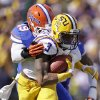 Photo - LSU wide receiver Odell Beckham (3) carries after a reception as Florida linebacker Darrin Kitchens (49) tries to tackle in the first half of an NCAA college football game in Baton Rouge, La., Saturday, Oct. 12, 2013. (AP Photo/Gerald Herbert)