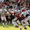 Jordan Evans (26) intercepts a pass during the University of Oklahoma Sooners (OU) practice and Student Day at Gaylord Family-Oklahoma Memorial Stadium in Norman, Okla., on Thursday, Aug. 21, 2014. Photo by Steve Sisney, The Oklahoman