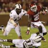 Oklahoma\'s Keith Ford (21) runs past Louisiana Monroe\'s Austin Moss (44) and Lenzy Pipkins (31) during the college football game between the University of Oklahoma Sooners (OU) and the University of Louisiana Monroe Warhawks (ULM) at the Gaylord Family Memorial Stadium on Saturday, Aug. 31, 2013 in Norman, Okla. Photo by Chris Landsberger, The Oklahoman