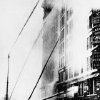FILE - In this March 25, 1911 file photo, firefighters work to put out the fire at the Triangle Shirtwaist Company in New York\'s Greenwich Village neighborhood. The fire that raced through a garment factory on Saturday, Nov. 24, 2012 in Bangladesh and killed 112 workers bore eerie echoes of another inferno that burned more than a century ago: the Triangle Shirtwaist factory fire in New York City. (AP Photo/File)