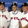 Photo - FILE - In this Dec. 9, 2013, file photo, retired managers, from left, Tony La Russa, Joe Torre and Bobby Cox gather for a photo after it was announced that they were unanimously elected to the baseball Hall of Fame during MLB winter meetings in Lake Buena Vista, Fla. La Russa will not have any logo on his cap in his Hall of Fame plaque, the Hall said Thursday, Jan. 23, 2014. Torre's will have a Yankees logo, while Cox's whill have a Braves logo.  (AP Photo/John Raoux, File)