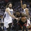 Photo - Miami Heat's LeBron James, right, is fouled by Charlotte Bobcats' Josh McRoberts, left, during the second half in Game 3 of an opening-round NBA basketball playoff series in Charlotte, N.C., Saturday, April 26, 2014. The heat won 98-85. (AP Photo/Chuck Burton)