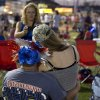 Bobby Patton, left, poses for a photo with his wife Ashton Patton during the Fourth of July celebration at Pioneer Park, Thursday, July 4, 2013 in Prescott, Ariz. On a day meant to ponder the nation\'s birth, and those who built and defended it over 237 years, Prescott\'s residents had 19 of their neighbors, their friends, their relatives to remember. Nineteen Granite Mountain Hotshot firefighters were killed Sunday by an out-of-control blaze near Yarnell, Ariz. (AP Photo/Julie Jacobson)