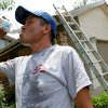 Photo - HEAT: Hector Ochoa, an employee at All Pro Roofing and Remodeling, takes a water break after working on a roof in Oklahoma City on Wednesday, June 2, 2010.  Photo by John Clanton, The Oklahoman ORG XMIT: KOD