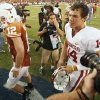 Texas quarterback Colt McCoy and OU quarterback Sam Bradford leave the field after the college football game between the University of Oklahoma Sooners (OU) and the University of Texas Longhorns (UT) at the Cotton Bowl on Saturday, Oct. 6, 2007, in Dallas, Texas. By Steve Sisney, The Oklahoman ORG XMIT: KOD