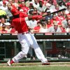 CORRECTS TO CAREER HIT WITH THE REDS, NOT JUST CAREER HIT - Cincinnati Reds\' Brandon Phillips (4) gets his 1,000th career hit with the Reds, in the second inning of a baseball game against the Miami Marlins on Sunday, April 9, 2012, in Cincinnati. (AP Photo/Ernest Coleman)