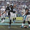 Carolina Panthers\' Cam Newton (1) celebrates his touchdown run against the Oakland Raiders during the first half of an NFL football game in Charlotte, N.C., Sunday, Dec. 23, 2012. (AP Photo/Bob Leverone)