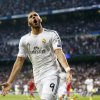 Photo - Real's Karim Benzema celebrates scoring the opening goal during a  Champions League semifinal first leg soccer match between Real Madrid and Bayern Munich at the Santiago Bernabeu stadium in Madrid, Spain, Wednesday, April 23, 2014. (AP Photo/Paul White)