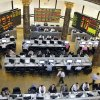 FILE - In this Wednesday, Oct. 29, 2008 file photo, Egyptian brokers work during a session at the Egyptian stock market in Cairo, Egypt. Egypt\'s benchmark stock index on Sunday plunged by more than 9.5 percent in the first trading session since the country\'s Islamist president issued decrees to assume sweeping new powers, while police in central Cairo fired tear gas at protesters who accuse the Egyptian leader of a blatant power grab. (AP Photo/Amr Nabil, File)