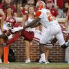 Oklahoma\'s Damien Williams (26) leaps past Florida A&M Rattlers safety John Ojo (25) for a touchdown during the college football game between the University of Oklahoma Sooners (OU) and Florida A&M Rattlers at Gaylord Family-Oklahoma Memorial Stadium in Norman, Okla., Saturday, Sept. 8, 2012. Photo by Bryan Terry, The Oklahoman