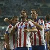 Atletico\'s Raul Garcia, center, celebrates his goal with teammates during a Spanish Supercup first leg soccer match against Real Madrid at Santiago Bernabeu stadium in Madrid, Spain, Tuesday, Aug. 19, 2014. (AP Photo/Andres Kudacki)