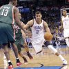 Oklahoma City\'s Thabo Sefolosha (2) drives past Milwaukee \'s Ekpe Udoh (13) during the season finally NBA basketball game between the Oklahoma City Thunder and the Milwaukee Bucks at Chesapeake Energy Arena on Wednesday, April 17, 2013, in Oklahoma City, Okla. Photo by Chris Landsberger, The Oklahoman