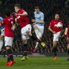Photo - Manchester City's Edin Dzeko, centre, scores his second goal against Manchester United during their English Premier League soccer match at Old Trafford Stadium, Manchester, England, Tuesday March 25, 2014. (AP Photo/Jon Super)