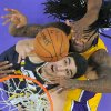 Photo - Utah Jazz center Enes Kanter, bottom, of Turkey, puts up a shot as Los Angeles Lakers center Jordan Hill defends during the first half of an NBA basketball game, Friday, Jan. 3, 2014, in Los Angeles. (AP Photo/Mark J. Terrill)